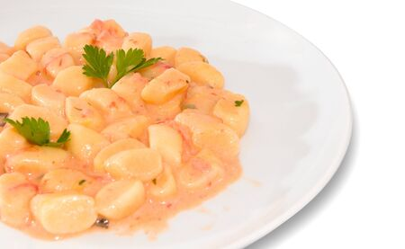 Potato dumplings with salmon ragout - Italian food Stock Photo