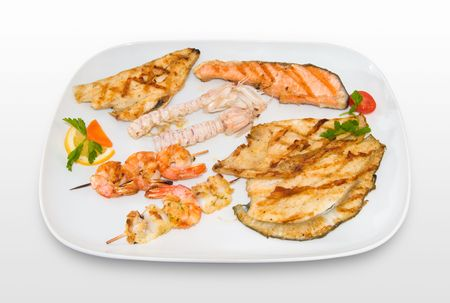 crustaceans: Grilled mixed fish with trout, prawn, salmon, cuttlefish and crustaceans.