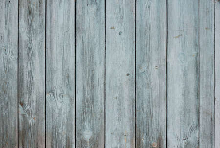 Grunge wood background with blue peeling paint photo