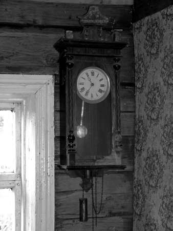 Very old clock on the wall of wooden house Stock Photo - 24207468