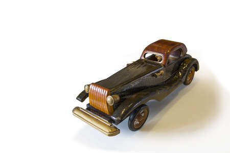 Ancient wooden toy car on withe background