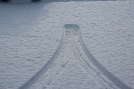 Tire tracks in the snow; photo