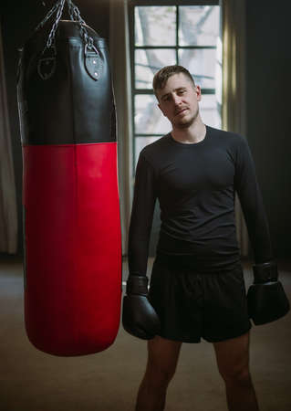 The man is an athlete boxing in the gym. Boxer practicing punches in the ring. Shadow-boxing. The athlete strikes with a punching bag. 4k video