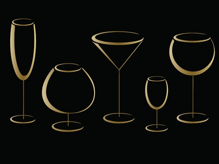 Golden glasses of alcohol drinks