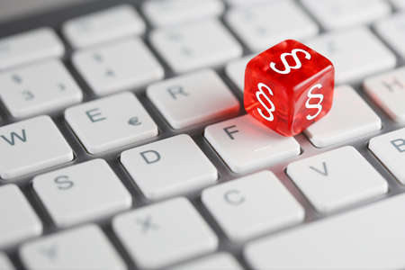 Dice with paragraph on keyboard
