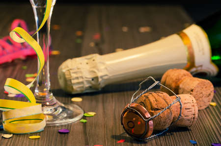 year financial statements: Silvester Party - champagne bottle with champagne glass and confetti Stock Photo