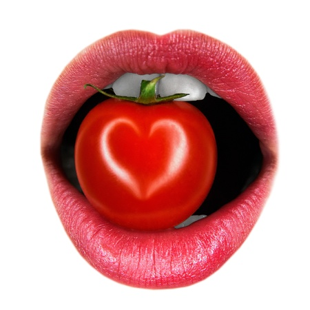 girl mouth: lips with tomato on a white background
