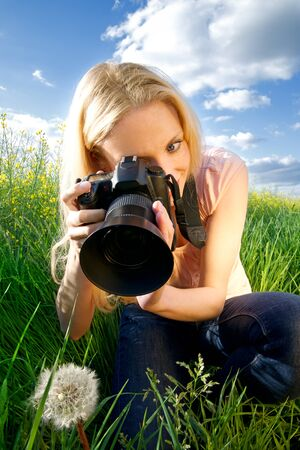 photographer with a flower photo
