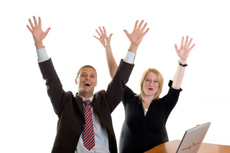 businessman and businesswoman cheering in office photo