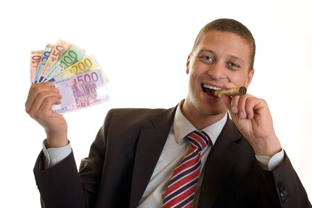 Businessman holding cigar and euro banknotes in hands photo