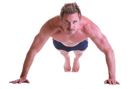 Man making pushups and looking seriously Stock Photo - 5170314