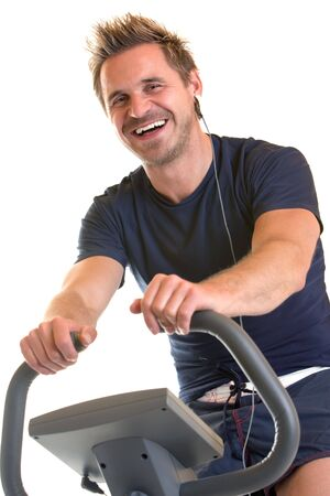 Man sitting on spinning bicycle Stock Photo - 5170289