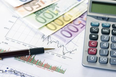 Closeup of a stock chart with Euro banknotes, calculator and pen photo