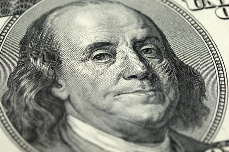 close-up of a hundred US Dollar banknote with   Benjamin Franklin photo