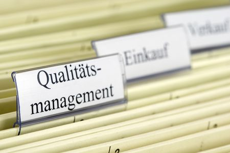 color consultant: Close-up hanging file Qualit�ts Management what means Quality Management in German