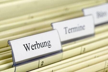 Close-up hanging folder Werbung what means Advertising in German photo