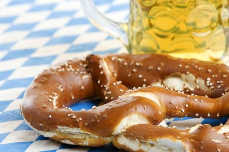 Bavarian Oktoberfest Pretzel and beer stein in background