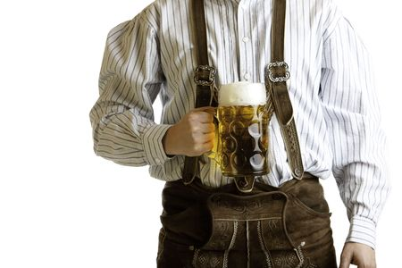 stein: Bavarian man dressed with original leather trousers holds an Oktoberfest beer stein into the camera Stock Photo