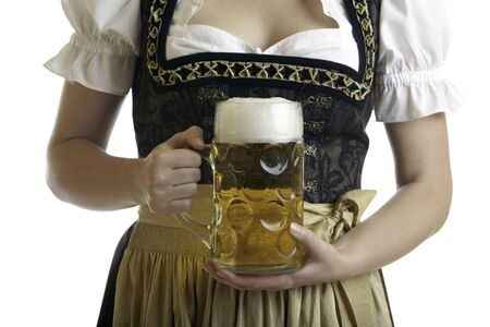 Bavarian Woman in Dirndl holds Beer stein in front of at Oktoberfest photo