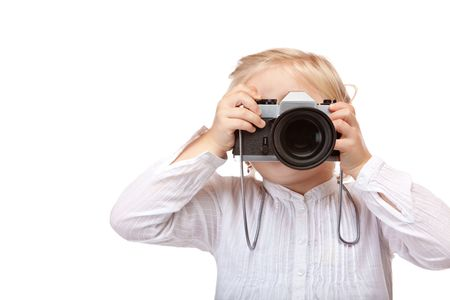 brainy: Closeup of child playing photographer with old slr camera. Isolated on white background. Stock Photo