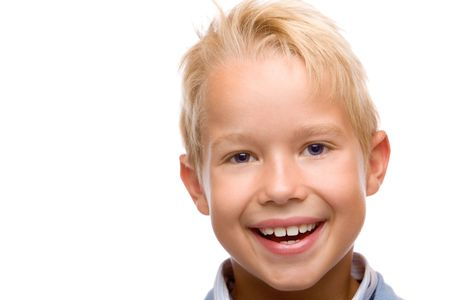 closeup of child smiling happy into camera on white background photo