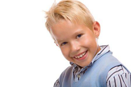 Young boy is happy and stands casual photo
