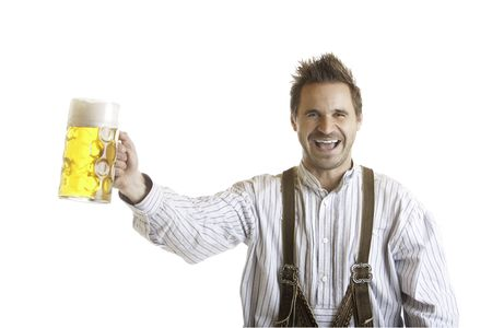 Bavarian Man dressed with traditional leather trousers (lederhose) holding Oktoberfest Beer Stein (Mass) photo