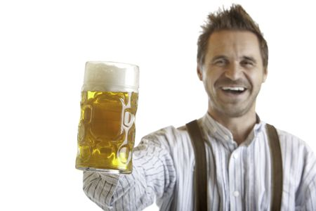 wiesn: Man smiles happy and holds an Oktoberfest beer stein