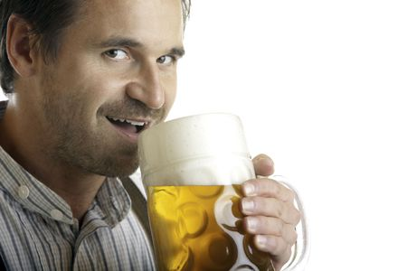 wiesn: Close-up of Bavarian man which drinks out of Oktoberfest beer stein Stock Photo