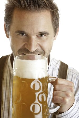 stein: closeup of an Bavarian man which wants to drink out of Oktoberfest beer stein Stock Photo