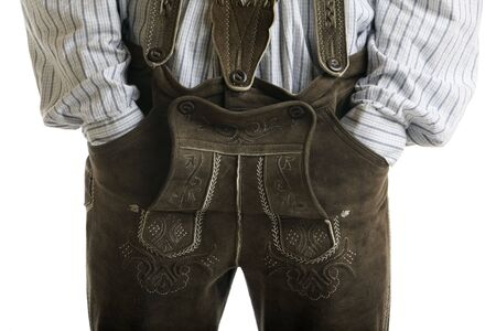 suspender: Close-up of original Oktoberfest Leather Trousers (Lederhose) worn by man with hands in pockets Stock Photo