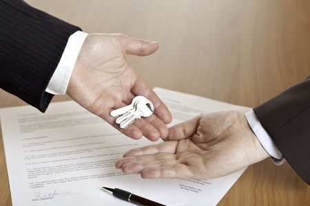 Handing over of house keys Stock Photo - 5598187