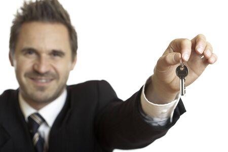 Handing over of house keys by businessman photo