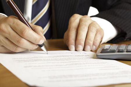 Closeup of hands signing a contract Stock Photo