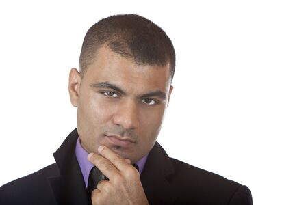 Closeup of businessman which looks contemplative into camera. Isolated on white background. Stock Photo - 5676181