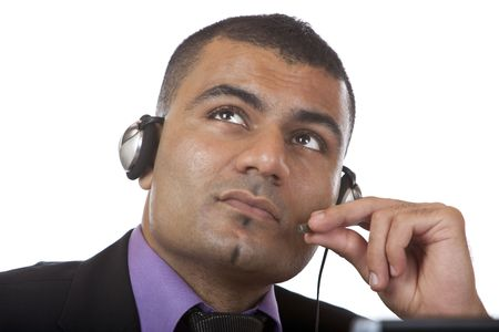 enquiring: Closeup of call center agent, holding microphone and thinks about a problem. Isolated on white.