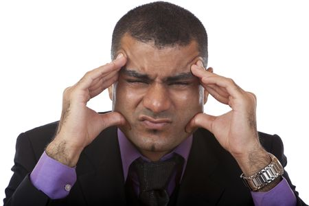 maladies: Overworked businessmann has headache because of stress