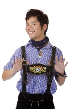 suspender: Closeup of Asian Boy dressed in Bavarian Oktoberfest cloth. Isolated on white. Stock Photo