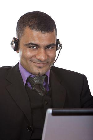 call center agent: Alzato di agente del centro di chiamata maschio esprimendo la positivit�. Isolated on white Archivio Fotografico