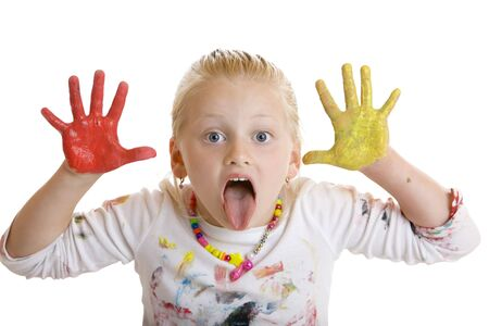 Closeup of child with painted hands makes a grimace photo