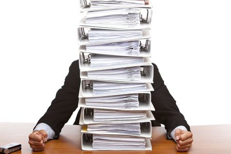 problematic: Businessman is frustrated, because of the huge documents he has to do. Isolated on white. Stock Photo