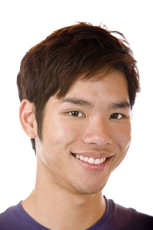 asian youth: Closeup of Asian man smiling happy into camera. Isolated on white. Stock Photo