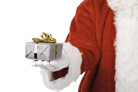 Closeup of hand of Santa Claus holding a Christmas gift. Isolated on white.