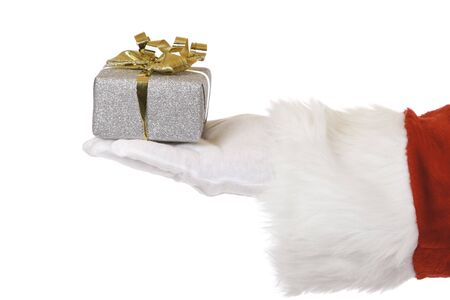 Closeup of hand of Santa Claus holding a Christmas gift. Isolated on white. Stock Photo - 5950566