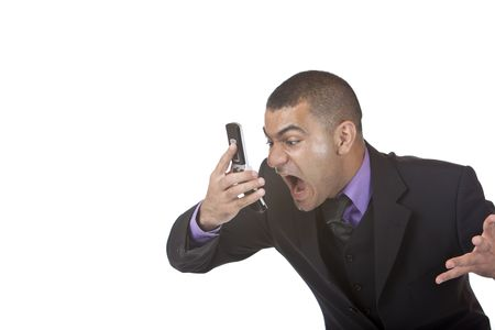 closeup of stressed businessman screaming in telephone. Isolated on white. photo