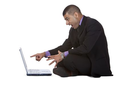 Businessman sitting on the floor and is suprised what he found on his laptop. Isolated on white background. Stock Photo - 5985206