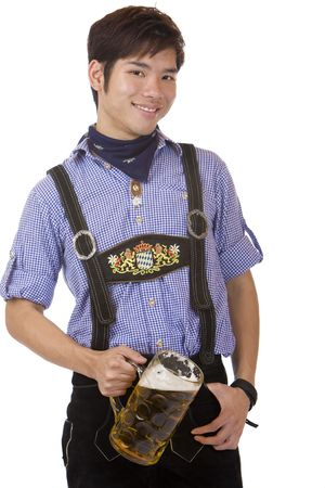 suspender: Asian Boy is holding a full Oktoberfest beer stein and smiles happy in camera. Isolated on white.