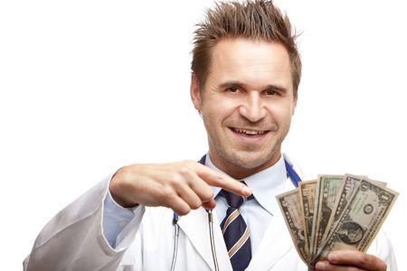doctor holding money: Closeup of doctor holding a  bundle of us dollar bills in his hand and points with other hand on it. Isolated on white. Stock Photo