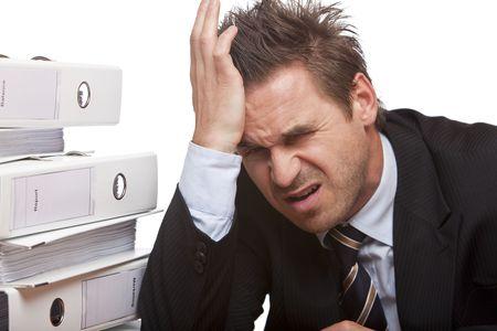 maladies: Closeup of face of businessman having heavy headache on white background.