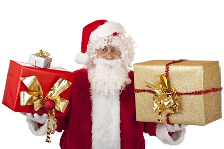 Closeup of old happy Santa Claus holding in each hand a Christmas present. Isolated on white. Stock Photo - 6057443